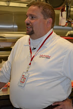 Photo: One of the indoor cooking competitors for Dibs On My Ribs shines in the media spotlight.