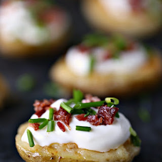 Mini Potato Skins with Sour Cream, Bacon, and Chives.
