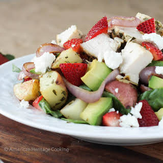 Grilled Onion Roasted Potato Strawberry Spinach Salad.