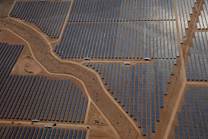 Aerial photo of a vast solar array in a desert climate