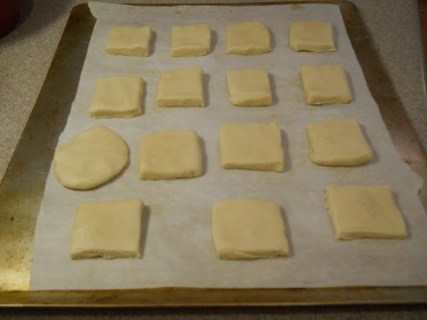 Place cut cookies onto cookie sheet covered in parchment paper. I prefer air-filled baking...