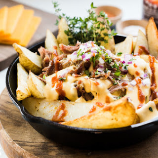 Pulled pork steak fries with Sriracha cheddar