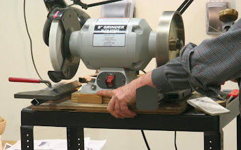 "Photo: Premeasured stop blocks on the grinder base are very handy for quickly setting the tool length out of your Vari-Grind or other gouge sharpening jig.  Chuck's are set to 1-3/4"" and 2-1/8""."