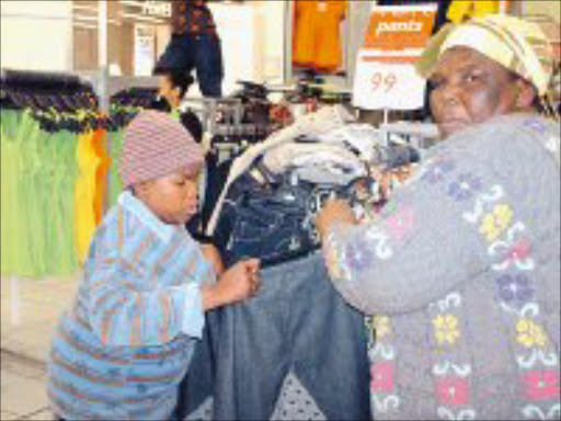 MY DAY: Mpho Mathibela and her mother, Sophie, check the size of the skirt Mpho will wear on her 21st birthday. Pic. Lindi Obose. 03/10/07. © Sowetan.