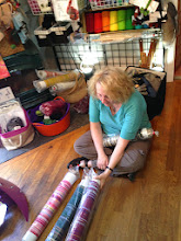 Photo: my student Deb choosing special Saori ready made warps to buy and take home.