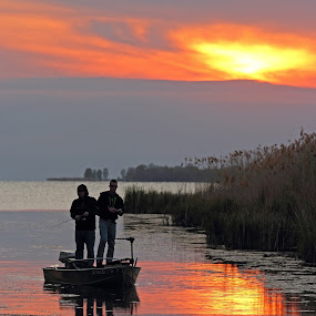 Fishing At Sunset by Bill Diller - People Street & Candids ( michigan, reflections, great lakes, fishing, saginaw bay, tranquil, water, boat, peaceful, calm, wildfowl bay, suinset, fishermen, calmness, tranquility, boating, lake huron )