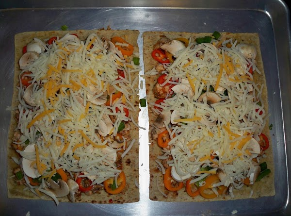 Top chicken with chopped mini bell peppers, green onions, mushrooms and cheeses.