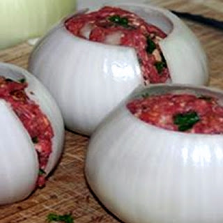 Man wraps an onion around beef… What he wraps around That? I'm sprinting to grill right Now!