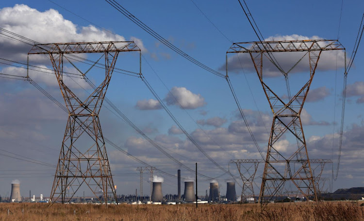 Electricity pylons are seen near cooling towers of South African petrochemical company Sasol's synthetic fuel plant in Secunda, north of Johannesburg.