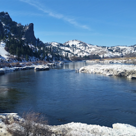 Missouri River Canyon by Don Evjen - Landscapes Waterscapes ( blue skies, snow, rugged peaks, pines, montana, river )