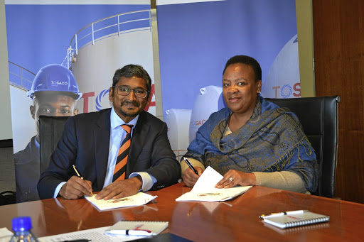 Stamp of approval:  Petroleum Agency SA CEO Lindiwe Mekwe, right, and Tosaco chairman Kinesh Pather sign documents. Picture: SUPPLIED