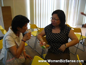 Photo: WBS Committee members, Lilian and Kim share a cosy moment together.