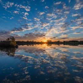October dreams by Matt Hollamon - Landscapes Sunsets & Sunrises ( reflection, sunset, nebraska, clouds, lake )