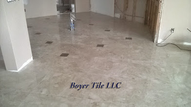 Photo: Finished marble floor installation, in this room. Very near perfect and very impressive piece of work.