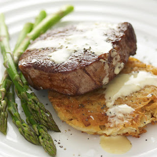 Steak with Potato Cakes and Mustard Sauce.
