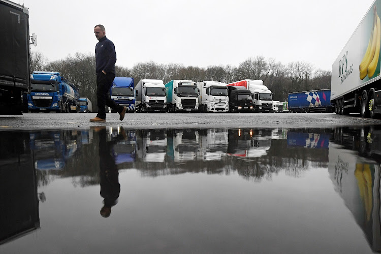 Lorries are parked up at Clacket Lane service area, as EU countries impose a travel ban from the UK after the Covid-19 outbreak, in Westerham, Britain on December 21 2020.