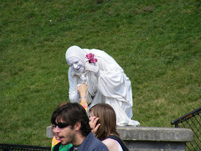 Photo: Living statues are seen in may parts of the city as part of the performance art.