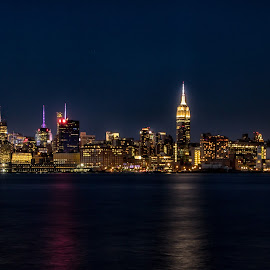 Night Time Manhattan Skyline by Carol Ward - City,  Street & Park  Skylines ( pier a park, manhattan sky, empire state building, night time, manhattan, hoboken, hudson river )