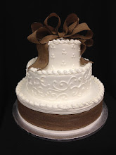 Photo: Rustic 3-tier wedding cake with burlap ribbon trim around bottom tier.