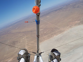 Photo: Banked into a thermal and climbing, Goat3 is soaring over the California desert in summer, 2006.  The orange yarn on the little mast is the yaw string, telling me I need a little more right  rudder. The ball on a line is the release handle, which I pulled to release the tow line at  the end of the aerotow, then wrapped around the nose tube to keep it out of the way.  The plastic tape on the nose tube is my pitch attitude indicator, I keep it visually on the  horizon, as shown, to maintain a constant airspeed. Mounted higher up on the nose tube (but not visible in this photo) is my soaring (and only) instrument, a combination audio variometer and digital altimeter