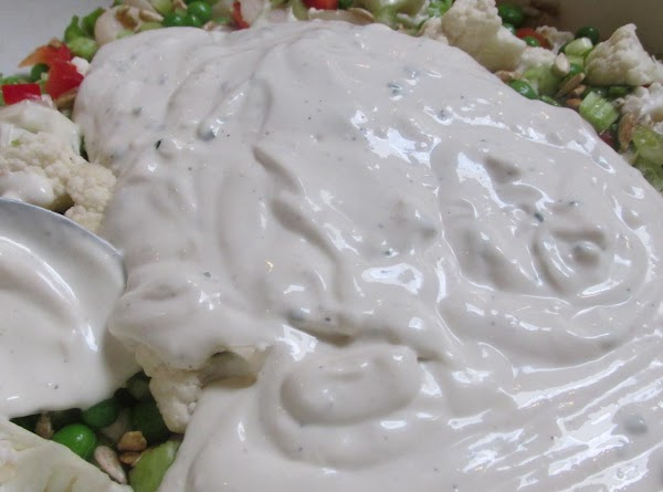 Now add the prepared salad dressing, and toss to make sure the vegetables are...