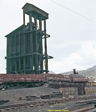 "Photo: 078-03.  ""Back"" of coaling tower, showing details of ramp construction.  Ash pit was out of sight at right on track in front of ramp.  7/28/60."