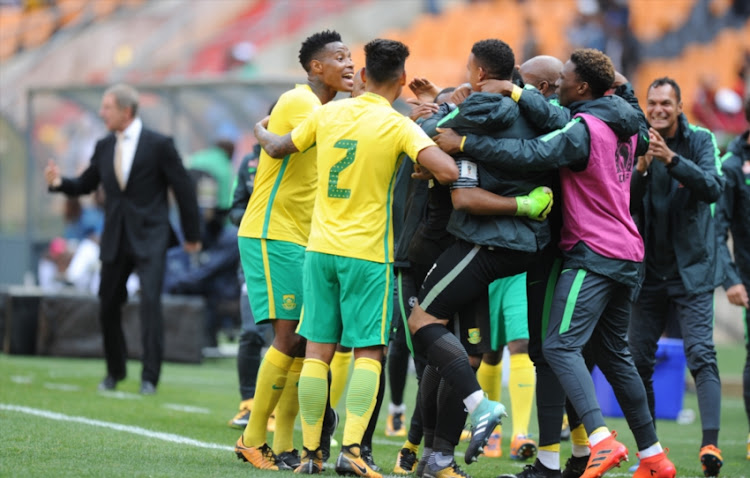 Bafana Bafana celebrating their victory against Burkina Faso during the FIFA 2018 World Cup, Qualifier match between South Africa and Burkina Faso at FNB Stadium on October 07, 2017 in Johannesburg, South Africa.