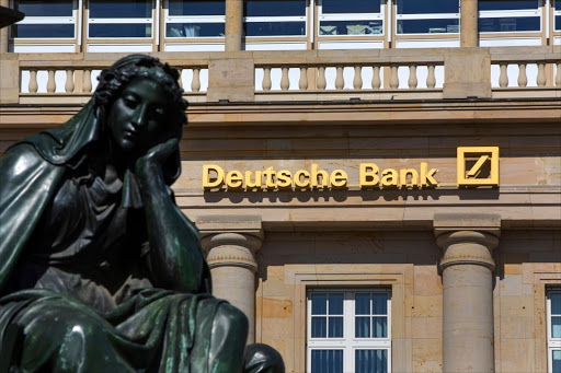 A sign above the entrance to a Deutsche Bank branch in Frankfurt. Picture:BLOOMBERG