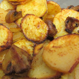 Potatoes With Onions And Mushrooms In The Oven.