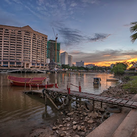 Sunset by PENDI KAMRI - Buildings & Architecture Homes ( sky, reflections, sunset, river, clouds, water, boat,  )