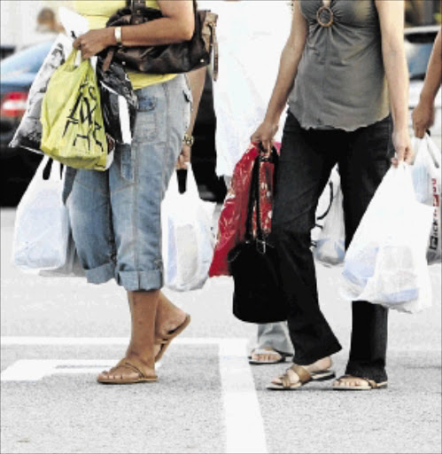 CURB YOUR ENTHUSIASM: Cutting out on non-essential shopping can make a big difference to your finances   Photo: Esa Alexander