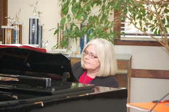 Photo: Marla Brock entertains at the piano.