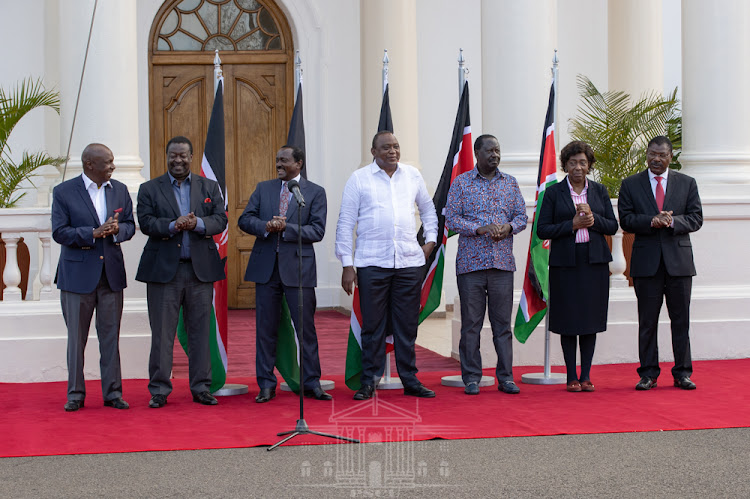 President Uhuru Kenyatta with party leaders Gideon Moi (Kanu), Musalia Mudavadi (ANC), Kalonzo Musyoka (Wiper), Raila Odinga (ODM), Kitui Governor Charity Ngilu (NARC) and Moses Wetang[ula (Ford Kenya) at State House,Nairobi, on Thursday, February 25,