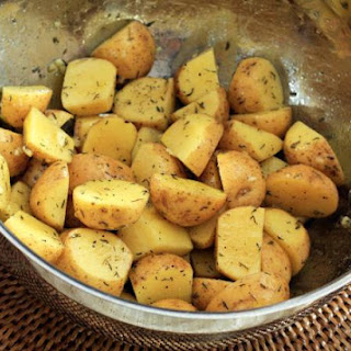 Roasted New Potatoes With Thyme and Garlic.