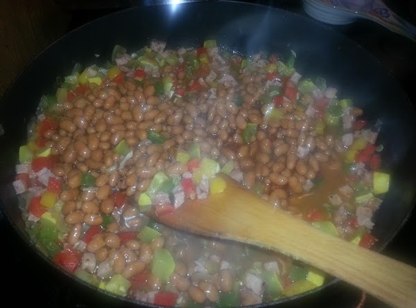 Now you can add whole can of baked beans, stir. Add smoked parpica ans salt...