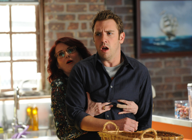 """Photo: BREAKING IN: Veronica (Megan Mullally, L) forces Cam (Bret Harrison, R) to help her make friends in the """"Game of Jones"""" episode of BREAKING IN airing Tuesday, March 27 (9:30-10:00 PM ET/PT) on FOX. ©2012 Fox Broadcasting Co. Cr: Ray Mickshaw/FOX"""