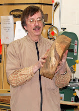 Photo: Gary discusses using an electric chain saw and the sawbuck to trim a square half log into a balanced octogon shape that is ready for the lathe.