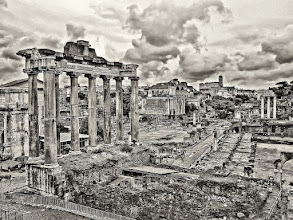 "Photo: Roman Forum on a rainy day This was a cold, rainy day, but I decided to go anyway, even if I've been there several times. While the colors were predictably bad, the atmosphere with the clouds was still interesting. So I decided to do this one in B&W, giving it this ""old drawing"" look similar to those etchings that were popular in the early '900. I hope you agree with my choice :-)."