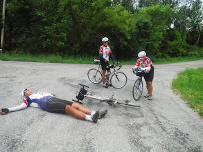 Photo: Day 50 Oneida Shores to Herkimer  No we did not have an accident, no Dale is not hurt. Dale decided to lay down, after wandering the hills above Herkimer Diamond Mines. Our route, after winding us through hills so far off the beaten track, that we saw one car, led us to a closed private street at which point we gave up and called Dave. Dave had to follow our route sheet to find us since Google couldnt navigate to where we were.