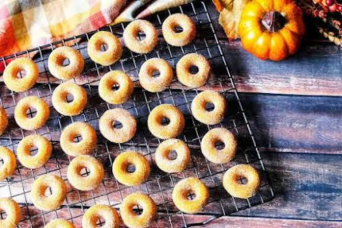 """Pumpkin Mini-Doughnuts""""These baked doughnuts are full of autumn goodness. They are very..."""