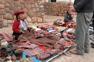 Photo: Not Cusco, but Chinchero. Those high quality textiles with natural dyes are rare and one of the large cloths is about $100. The very bright colors are always synthetic dyes.