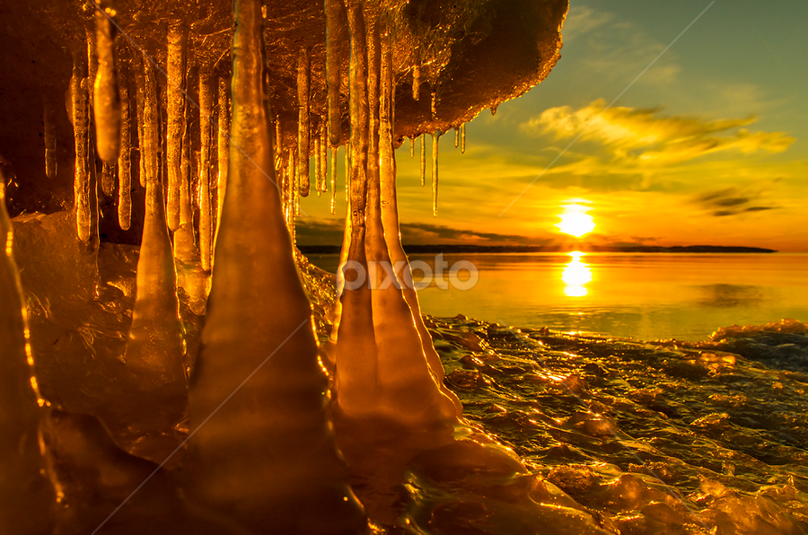Icicles in sunset by Peter Samuelsson - Landscapes Waterscapes