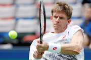 Kevin Anderson of South Africa in action against Novak Djokovic of Serbia at the Shanghai Masters in Shanghai, China, on October 12, 2018.