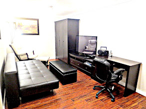 Photo: TV ROOM HAS 50 INCH HIGH DEFINITION TV, LEATHER COUCH AND RECLINER