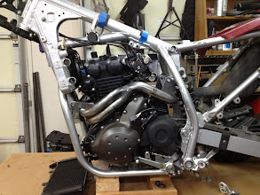 Photo: Frame done, motor mounted and exhaust done, fitting radiator.  Throttle bodies mounted upside down for better clearance, new bell crank made.