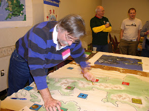 Photo: DK moves the tiles on the campaign map showing where battles were fought, won and lost.