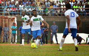 Photo: Abduali Baggie marshalls his team mates  [Leone Stars v Swaziland 31 May 2014 (Pic: Darren McKinstry)]