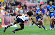 Herschel Jantjies of the DHL Stormers goes past Henry Speight of the Brumbies during a Super Rugby game at Newlands Rugby Stadium in Cape Town on April 20 2019.