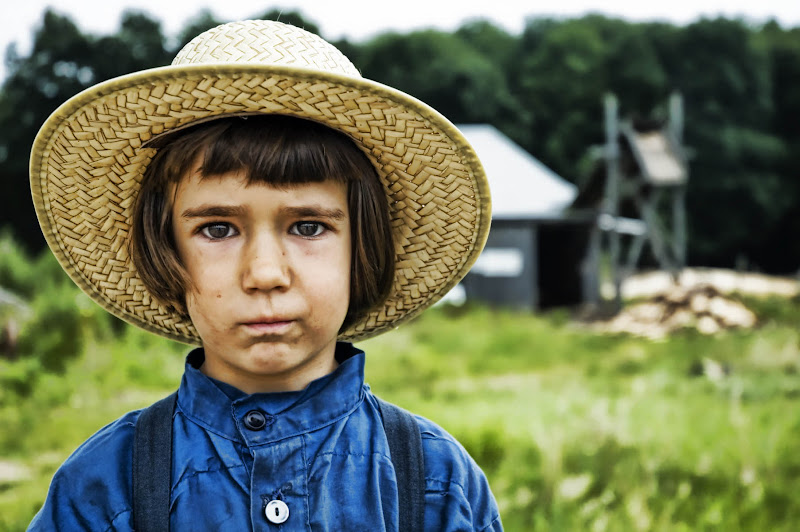 Photo: This is Nathaniel  Nathaniel is currently four years old and carrying wood with his two sisters down a dusty cart-road in an unmarked Amish village somewhere between Allegheny and Tionesta, Pennsylvania. In pauses between talking to me, he looks sideways at his older sisters, who peacefully nod towards him. I tell him that he looks big and strong and then I help him carry the wood to his parents' home, where he lives with his other nine brothers and sisters.  from Trey Ratcliff at the blog http://www.stuckincustoms.com