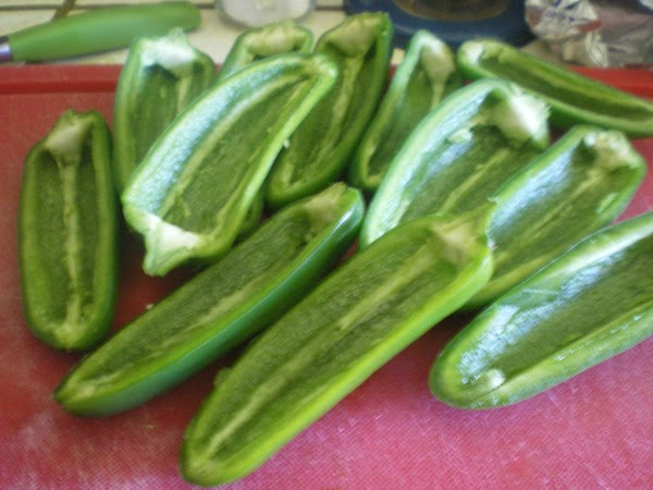 Cut the jalapenos in half.  Remove seeds, and trim as much of the...